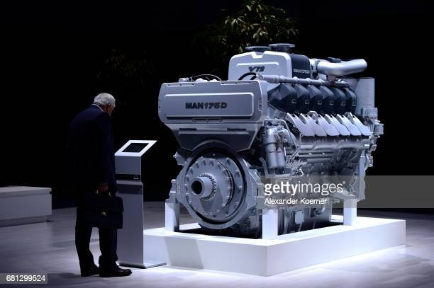 A visitor looks on a MAN Truck diesel engine during the company's annual general shareholders meeting on May 10 2017 in Hanover Germany While the...