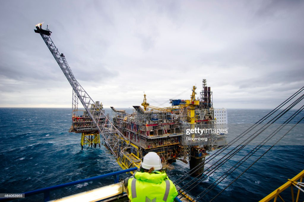 A visitor looks out towards a flare stack on the Oseberg A offshore gas platform operated by Statoil ASA in the North Sea 140kms from Bergen, Norway, on Friday, Jan. 17, 2014. Statoil, Norway's biggest energy company, sees the potential to keep domestic oil and gas output at today's levels until 2025 and possibly beyond even as it tightens spending amid rising costs. Photographer: Kristian Helgesen/Bloomberg via Getty Images