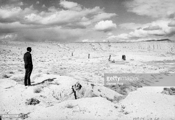 A visitor looks over a subsidence crater formed by the 200kiloton Project Bilby blast in 1963 Blast was felt in Las Vegas Nev 70 miles south Denver...