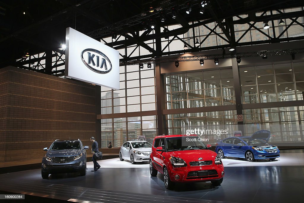 A visitor looks over cars in the Kia display during the media preview at the Chicago Auto Show on February 7, 2013 in Chicago, Illinois. The Chicago Auto Show, one of the oldest and largest in the country, will be open to the public February 9-18.