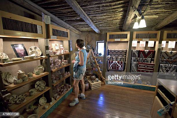 A visitor looks over items on display in the Hopi House at Grand Canyon National Park in Grand Canyon Arizona US on Thursday June 25 2015 The Grand...