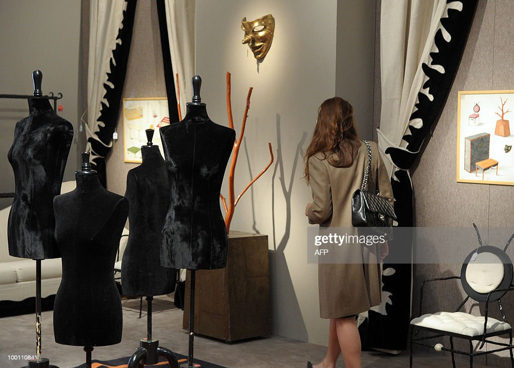 A visitor looks stockmens designed by Elizabeth Garouste and Mattia Bonetti for French fashion house Christian Lacroix among about 100 lots exhibited at the auction house Sotheby's France in Paris on May 21, 2010 before a sale on May 26, 2010 organised at the initiative of Christian Lacroix Company. In 1987 Christian Lacroix hired furniture designers Garouste and Bonetti to create the complete bespoke interior of his fashion house located on the Parisian Faubourg Saint Honore. Apart from the salons, the team also designed the packaging, the writing paper, the logo.