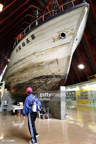 Visitor looks the fishing boat DaiGo Fukuryu Maru on display in Tokyo on 5 November 2016 which exposed to nuclear fallout at the United States'...
