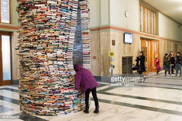 Visitor looks the inside of Idiom installation, created by Slovakian artist, Matej Kren, is seen at Prague Library in Prague, Czech Republic on...