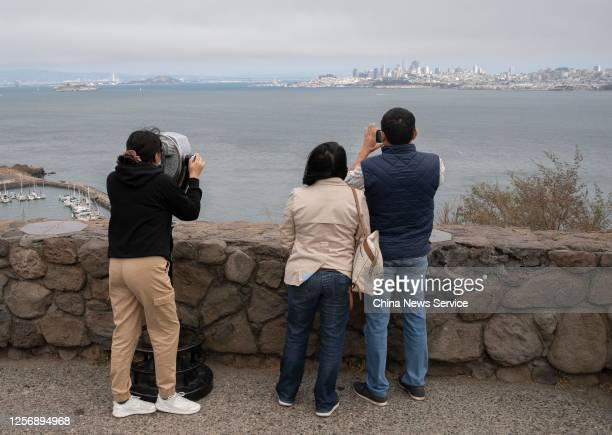 Visitor looks through binoculars at the Vista Point near the Golden Gate Bridge amid the COVID-19 pandemic on July 17, 2020 in Sausalito, California.