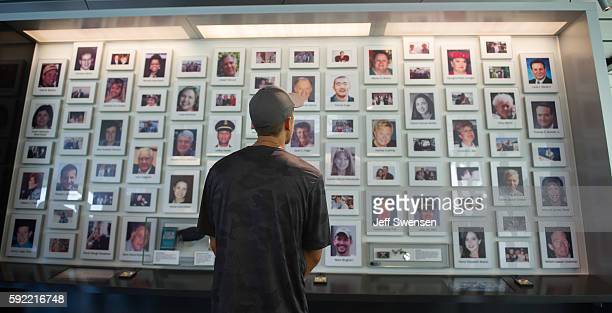 A visitor looks through the portraits of the victims of Flight 93 at the Flight 93 National Memorial in Shanksville Pennsylvania on August 19 2016...