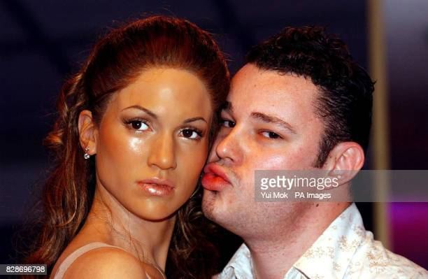 Visitor Marcus Fitzgerald from London examines a new waxwork model of Jennifer Lopez whose cheeks turn pink when someone whispers in her ear as part...