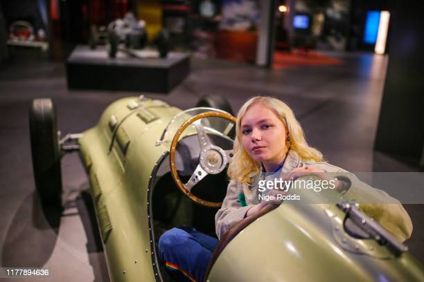 Visitor Marti McCormick sits in an E-type GP1 replica from 1939 during media day ahead of the Silverstone Experience opening at Silverstone Circuit...
