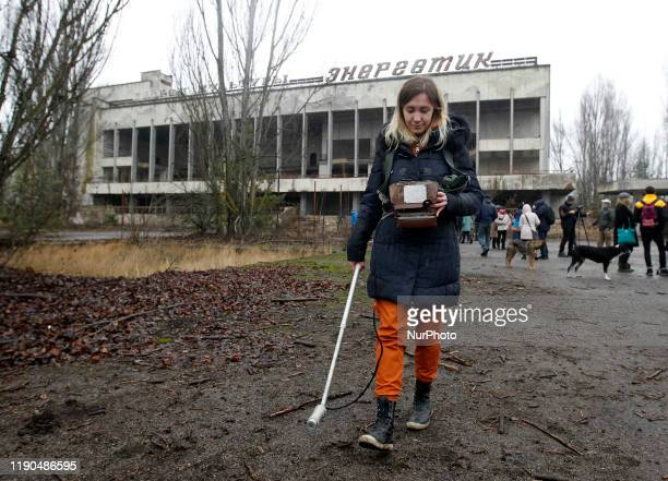 A visitor measures the level of radiation in an abandoned city of Pripyat in Chernobyl Ukraine on 25 December 2019 The Chernobyl disaster on the...