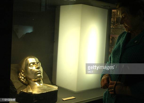 A visitor observes a mask of Eva Peron at Peronism Museum in San vicente Buenos Aires province September 15 2004