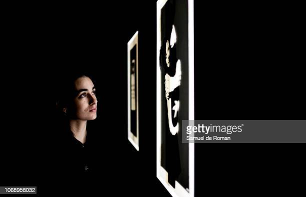 A visitor observes a picture during Banksy Exhibition at IFEMA on December 6 2018 in Madrid Spain