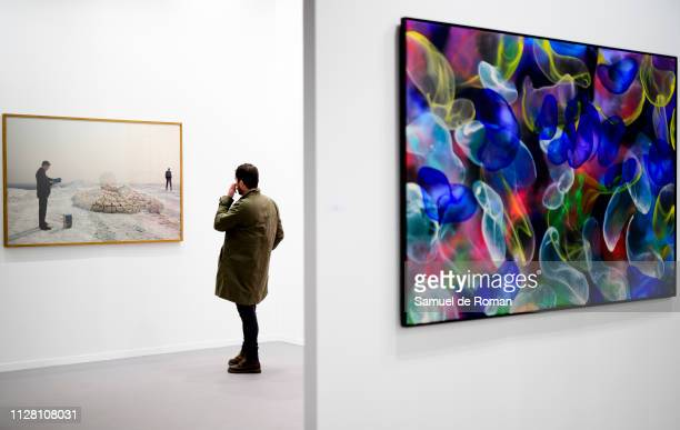Visitor observes a picture during the 38th International Contemporary Art Fair held in Madrid, at Ifema on February 28, 2019 in Madrid, Spain.