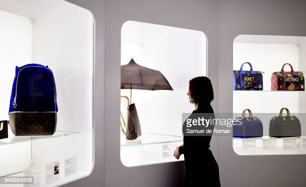 A visitor observes a work by Lous Vuitton during 'Time Capsule' by Louis Vuitton Exhibition on April 16 2018 in Madrid Spain