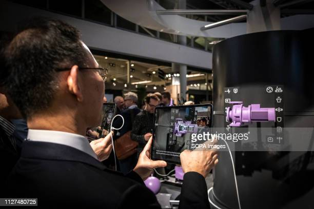 A visitor observes Ericsson's VR virtual reality system during the MWC2019 The MWC2019 Mobile World Congress opens its doors to showcase the latest...
