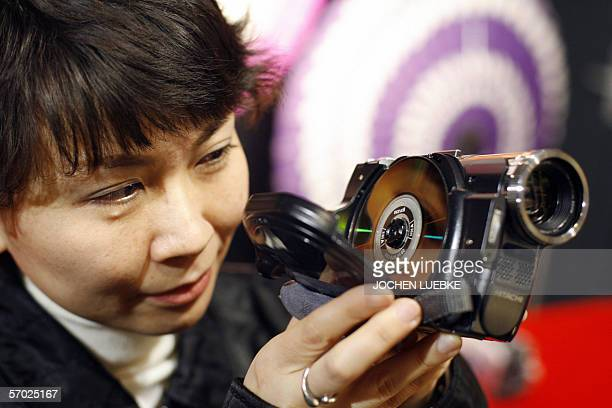 Visitor of the 2006 CeBIT information and telecommunication technology fair inspects a Hitachi camcorder recording films on a DVD, 08 March 2006 on...