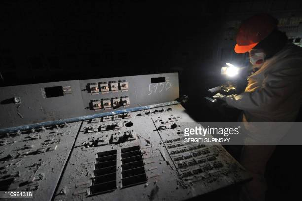Visitor of the Chernobyl Nuclear Power Plant films in the control room of the destroyed 4th block of the plant on February 24, 2011 ahead of the 25th...