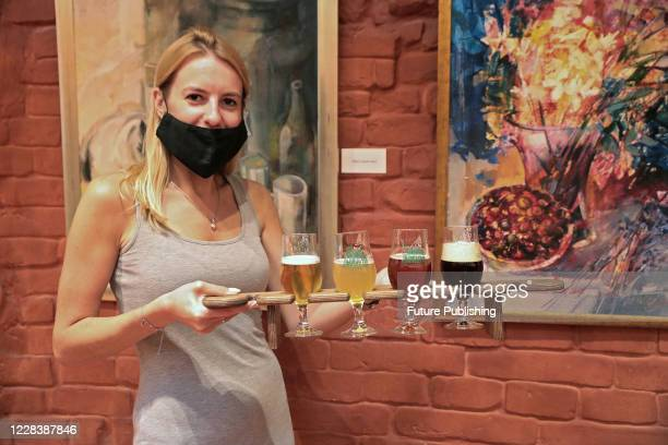 """Visitor of the """"Lvivarnia"""" Museum and Cultural Complex of Brewing History is pictured during the beer degustation, Lviv, Ukraine.- PHOTOGRAPH BY..."""