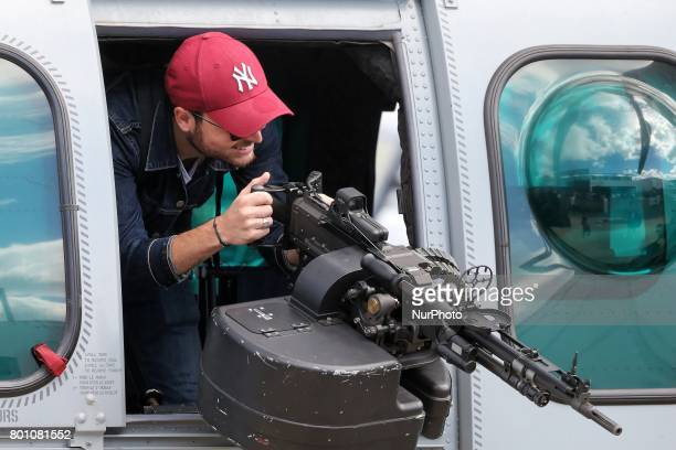 A visitor on the Caracal military helicopter on the last day of the International Paris Air Show at Le Bourget Airport near Paris on June 25 2017...