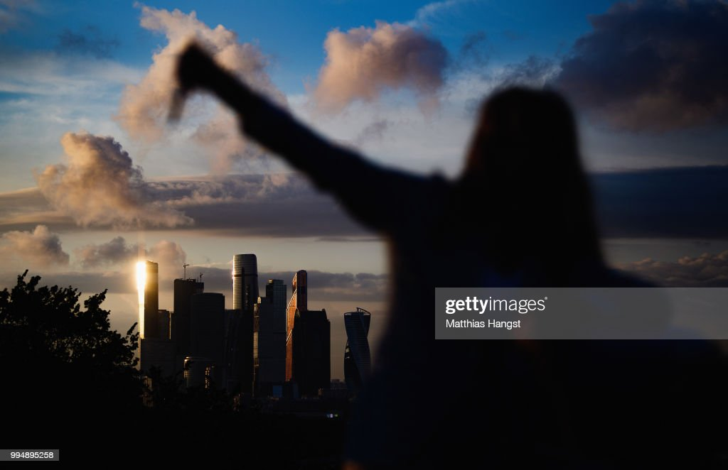 A visitor on Vorobyovy Hills takes a selfie in front of the the skyscrapers of the Moscow International Business Center, also known as 'Moscow City' ahead of the 2018 FIFA World Cup semi-final match between England and Croatia on July 9, 2018 in Moscow, Russia.