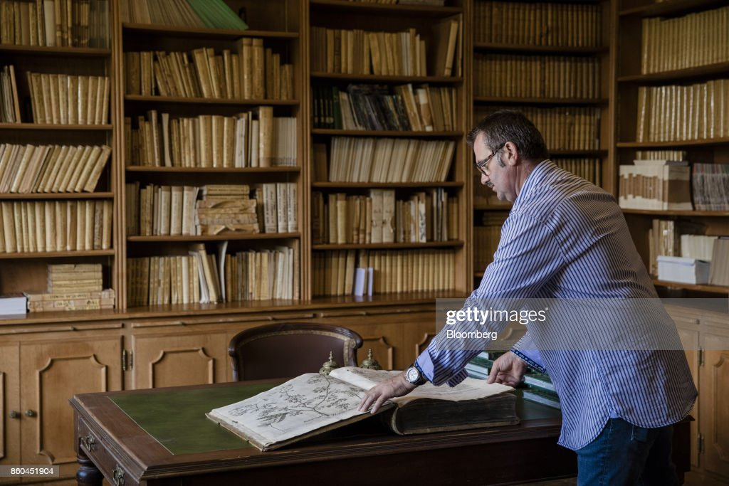 A visitor opens the pages of a 1640 edition of a botanicalcodex in the library of the VillaLes Cedres, a 187-year-old, 18,000-square-foot, 14-bedroom mansion set on 35 acres, in Saint-Jean-Cap-Ferrat, France, on Tuesday, Sept. 26, 2017. With a list price of 350 million ($410 million), the owner, the Italian distiller Davide Campari-Milano SpA, is betting that the houses combination of history, luxury, and a prime location along the coast of Saint-Jean-Cap-Ferrat will be enough to make it the most expensive residential sale in history. Photographer: Marlene Awaad/Bloomberg via Getty Images