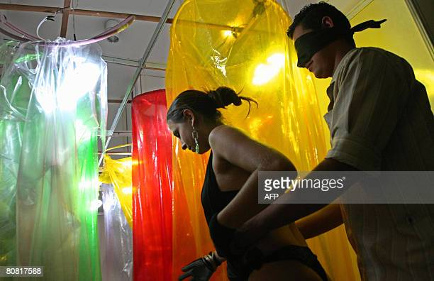 A visitor participates on April 19 2008 in the 12th Erotika Fair Latin America's biggest erotica trade show held at the exhibition hall Mart Centre...