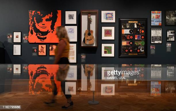 A visitor pases photos and platinum records displayed during a press preview of the exhibition 'Ed Sheeran Made in Suffolk' in Ipswich east England...