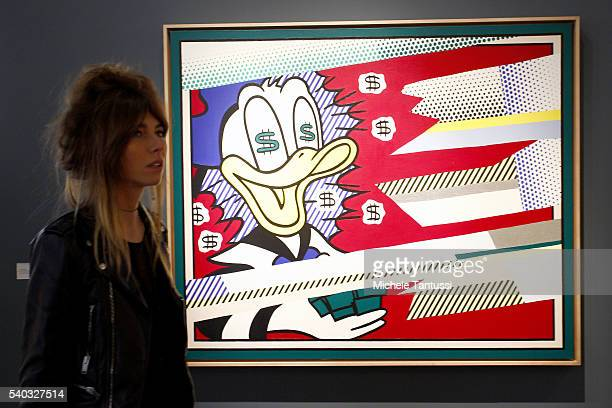 A visitor pass by the artwork of the Artist Roy Lichtenstein Portrait of a Duck exposed in the Galleries Area during the press preview for Art Basel...