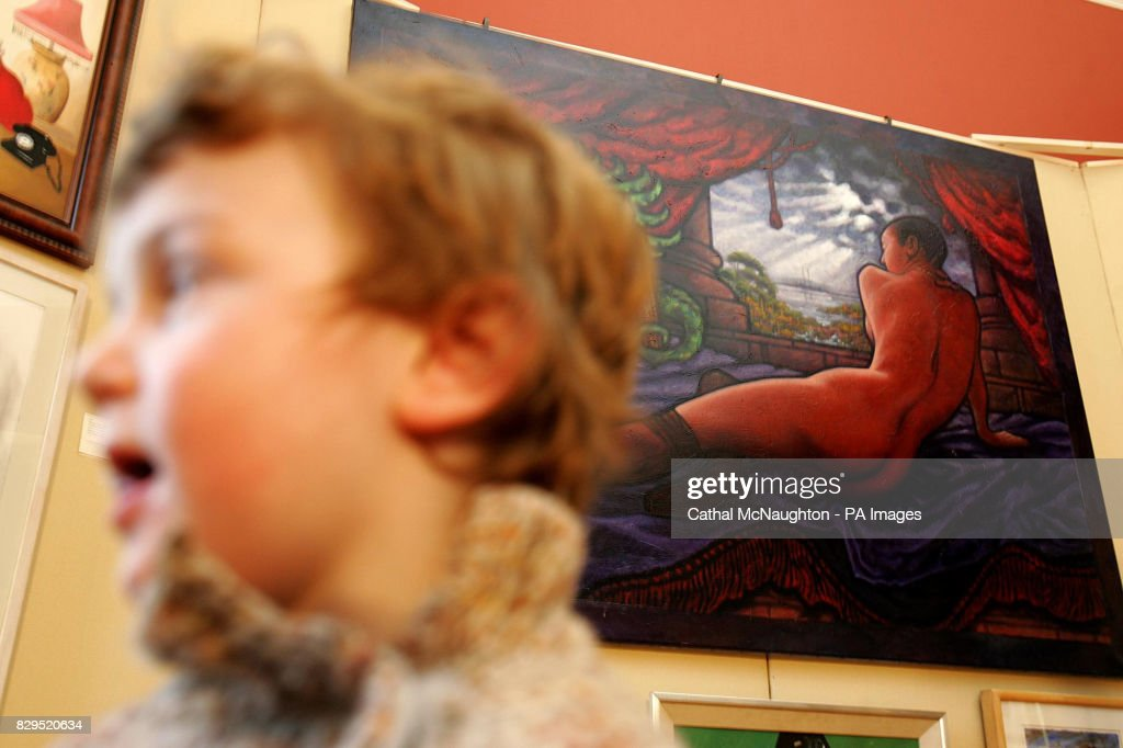 A Visitor Passes A Naked Portrait Of Controversial Irish Singer