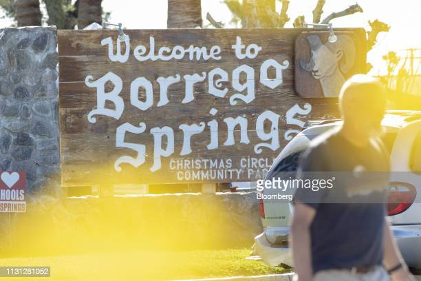 A visitor passes a park sign during a 'super bloom' in Borrego Springs California US on Sunday March 17 2019 California is free of drought for the...