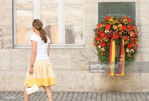 A visitor passes a plaque dedicated to the memory of the planners of the 1944 assassination attempt on Adolf Hitler on the 69th anniversary of the...