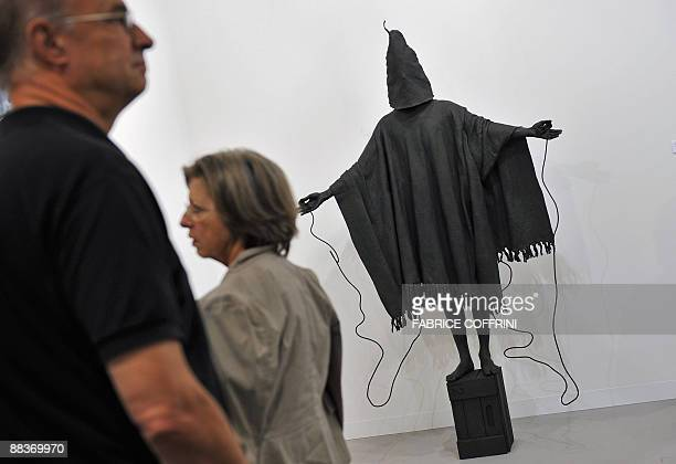 Visitor passes by a 2855 kg patinated bronze sculpture by British artist Marc Quinn entitled Mirage and inspired by a picture taken at Abu Ghraib...