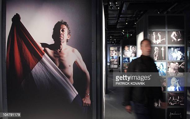 A visitor passes by a picture of French artist Serge Gainsbourg on October 16 at the 'Gainsbourg 2008' exhibition in the Cite de la musique in Paris...