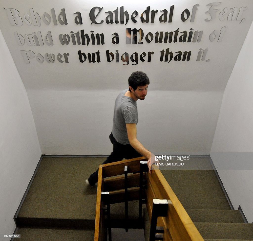 A visitor passes by one of instalations in the staircase of the 'D-0' art museum on April 26, 2013 after the opening ceremony of Second Art Biennale in the Bosnian town of Konjic. The art museum is placed inside of a former strategic nuclear shelter built by the Communist regime, 180 meters underground. Construction of the 'D-0' shelter was completed as the cold war era was coming to end and was never used by the military. It was maintained by the former Yugoslav Army until the war broke out in Bosnia in 1992. During the war, most of the equipment was preserved by the Bosnian Army until 2011, when the communist era relic was turned into an art museum.