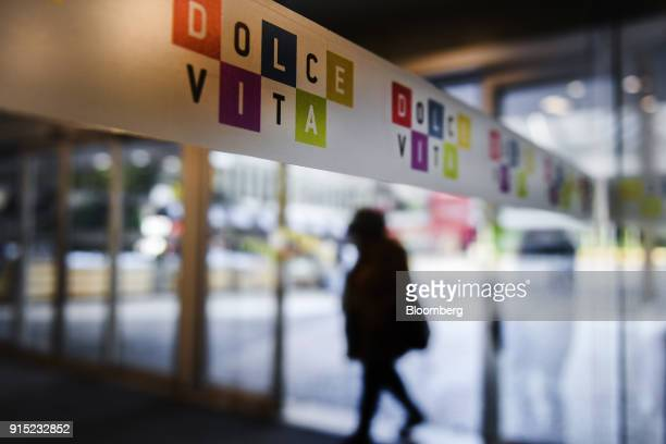A visitor passes colorful signage at the entrance to the Dolce Vita Tejo shopping mall operated by AXA Real Estate Investment Managers SGR SpA in...