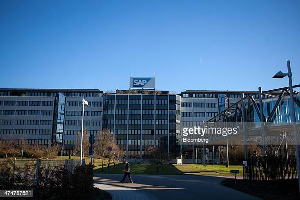 A visitor passes outside the headquarters of SAP AG in Walldorf Germany on Monday Feb 24 2014 SAP AG coChief Executive Officer Bill McDermott...
