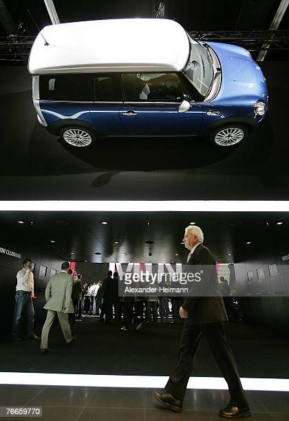 A visitor passes the Mini Cooper stand during the pressdays of the 62nd International Motorshow IAA on September 11 2007 in Frankfurt Germany From...