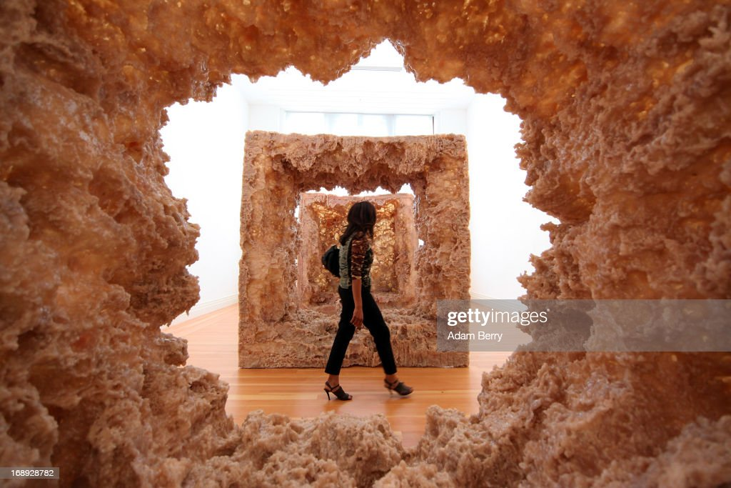A visitor passes the sculpture '1st Body' (2013) prior to the opening of the 'Kapoor in Berlin' exhibition at the Martin Gropius Bau on May 17, 2013 in Berlin, Germany. The 1991 Turner Prize winner, who is considered one of the most influential sculptors of his generation, has created around half the works specifically for the exhibition in Berlin, which runs at the Martin Gropius Bau from May 18 to November 24.