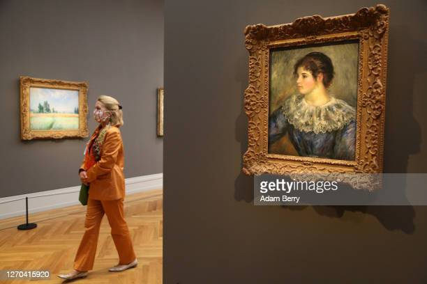 """Visitor passes through the exhibition during the press preview for """"Impressionismus. Die Sammlung Hasso Plattner"""" at Museum Barberini on September..."""