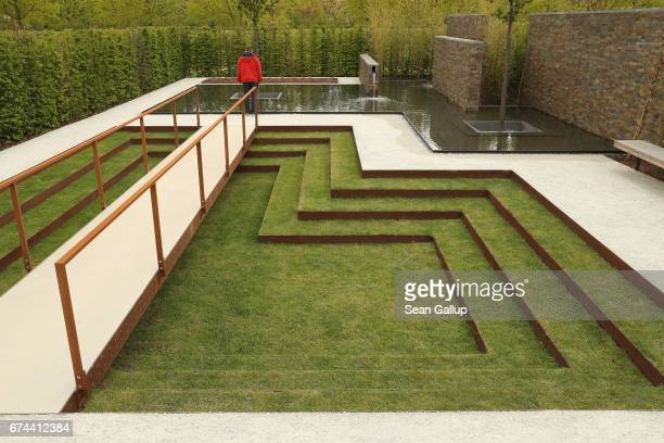 A visitor pauses at a Brazilian garden at the IGA 2017 international garden exhibition on April 28 2017 in Berlin Germany The IGA includes...