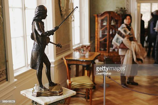 A visitor pauses to look at a small statue of Austrian composer Wolfgang Amadeus Mozart in the room where Mozart stayed and composed on several...
