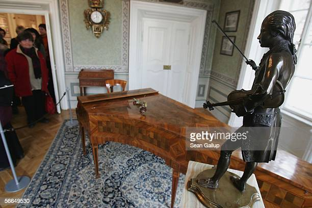 A visitor pauses to look at an original harpsichord and a small statue of Austrian composer Wolfgang Amadeus Mozart in the room where Mozart stayed...