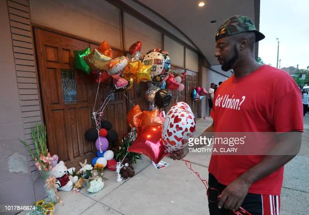 A visitor pays his respects at a temporary memorial set up for late singer Aretha Franklin at New Bethel Baptist Church in Detroit Michigan on August...