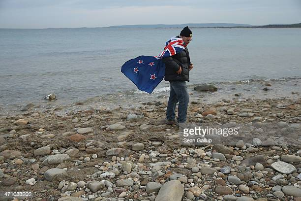 Visitor Phil Pirie from New Zealnbd and who is wearing a New Zealand flag walks along the beach at Anzac Cove where one hundred years before...