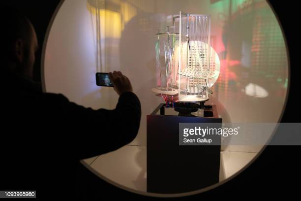 A visitor photographs a light prop by Laszlo MoholyNagy at 'Bauhaus 100 Years The Opening Festival' during a press preview at the Akademie der Künste...