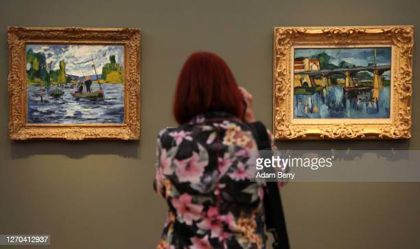 """Visitor photographs artworks during the press preview for the exhibition """"Impressionismus. Die Sammlung Hasso Plattner"""" at Museum Barberini on..."""