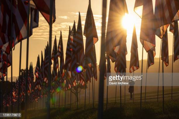 Visitor photographs flags during the 14th annual Waves of Flags on the eve of the 20th anniversary of the September 11 terror attacks in Alumni Park...