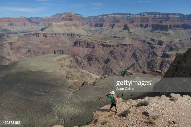 A visitor photographs from Skeleton Point on the South Keibab Trail at the Grand Canyon South Rim on July 13 2014 at Grand Canyon National Park...