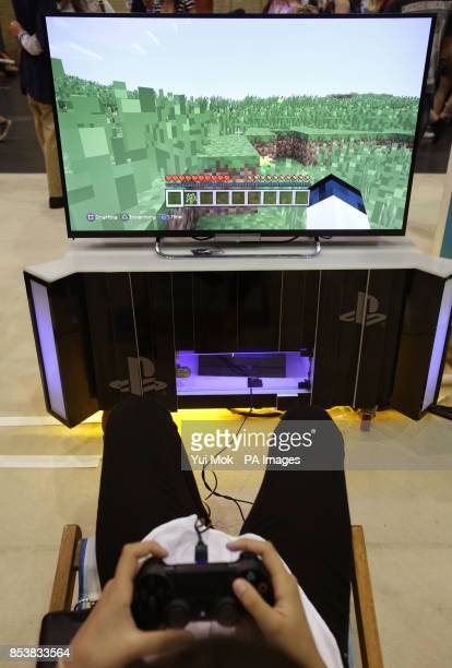 A visitor playing a game of Minecraft at the Summer in the City festival the UK's largest YouTube community event at Alexandra Palace in London