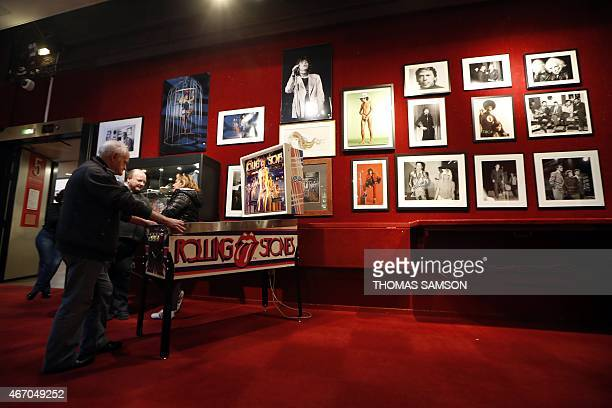 A visitor plays a collectible original 1980 US Bally Corp 'Rolling Stones' pinball as original prints of various artists are displayed at the Drouot...