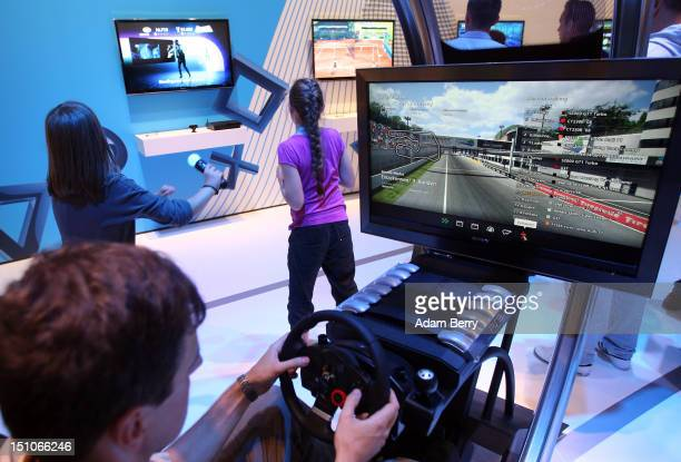 A visitor plays a driving simulator racing game on a Playstation 3 video console during the Internationale Funkausstellung 2012 consumer electronics...